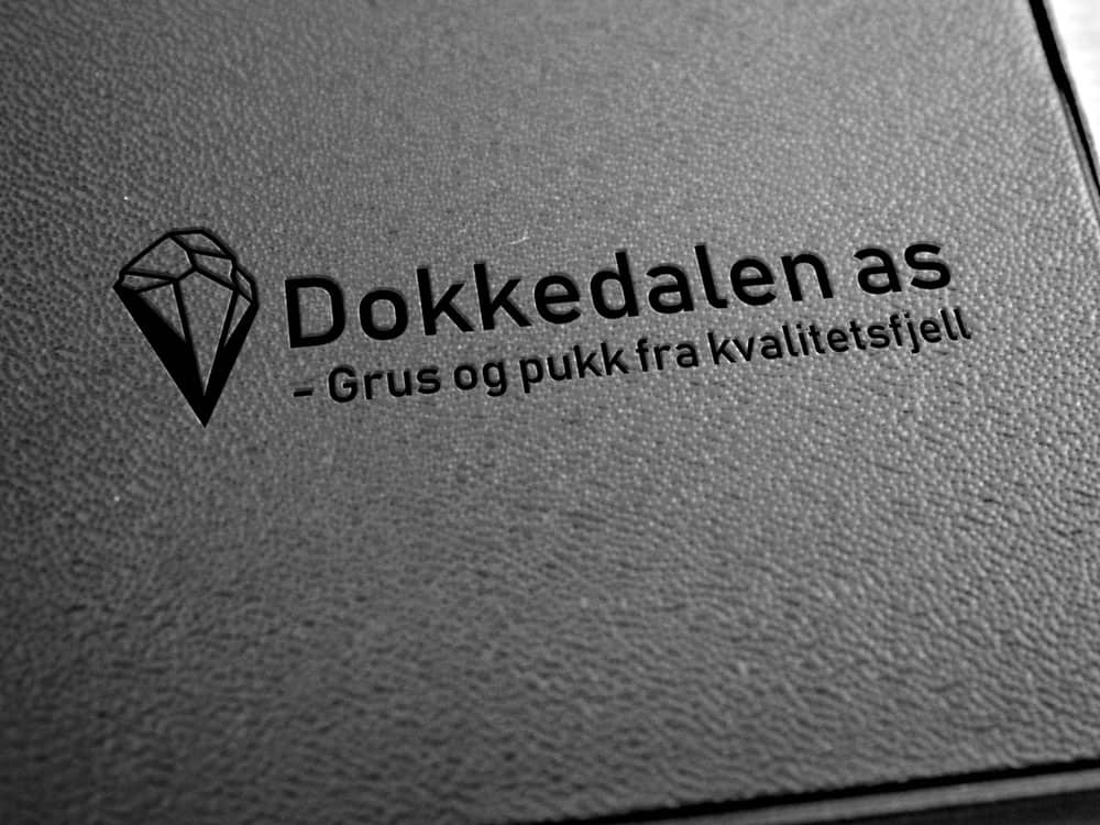 Dokkedalen AS, logo